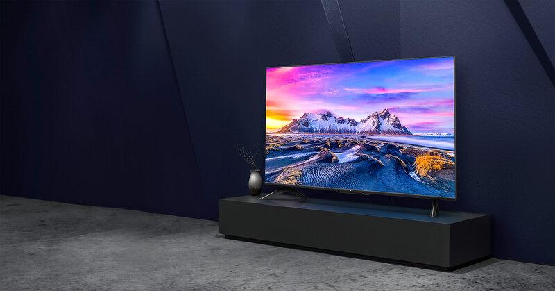 Mi TV P1 televisio toistamassa sisältöä mustan televisiotason päällä