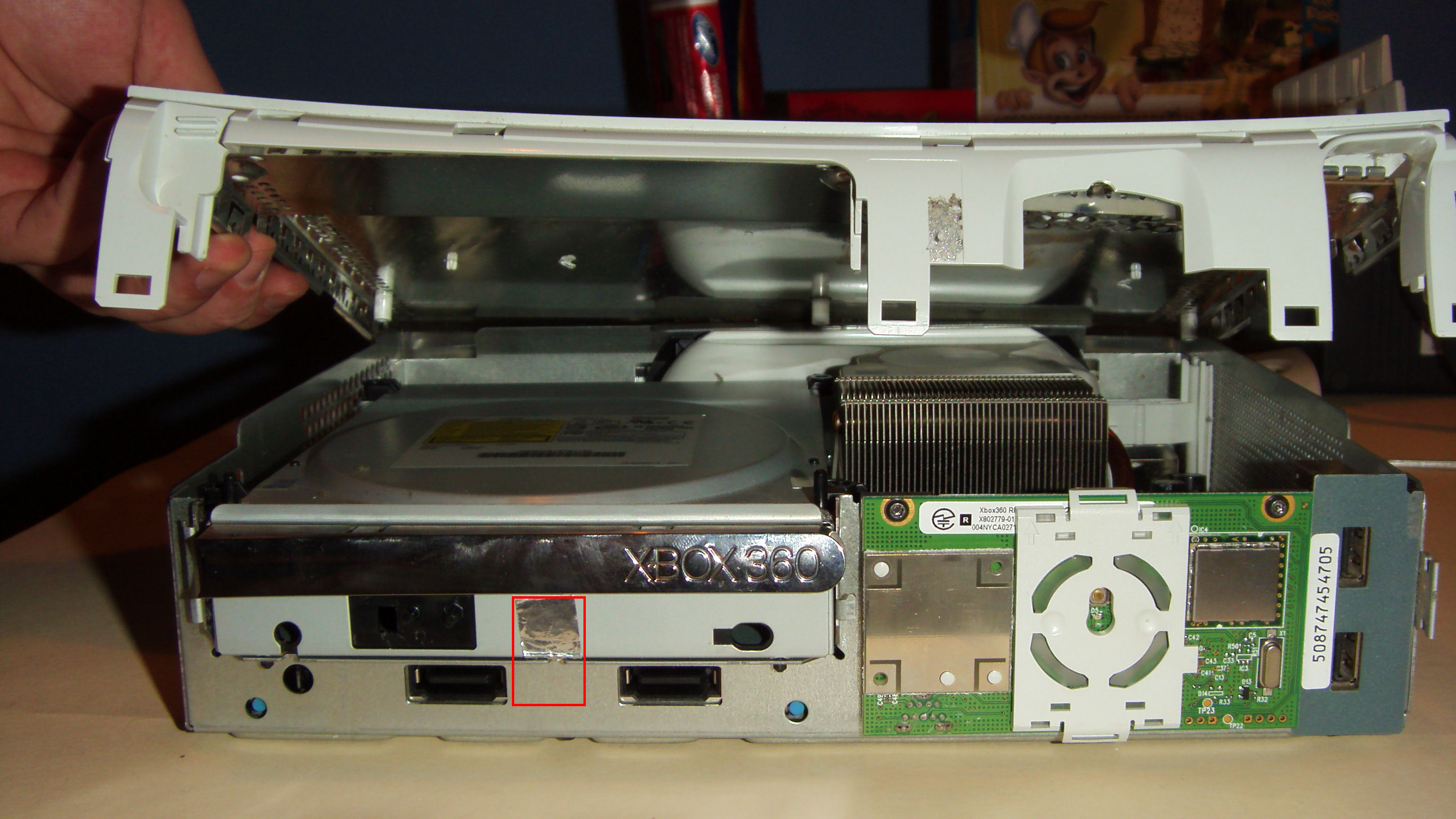 how to remove xbox 360 dvd drive magnet